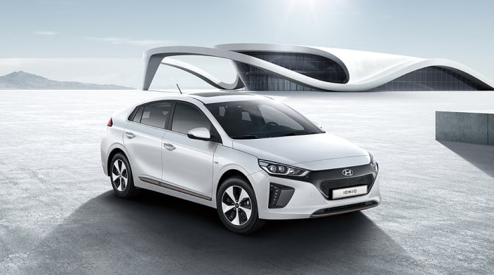 Side front view of white Ioniq Electric parked outside